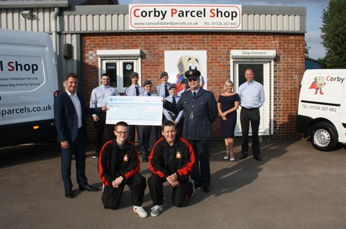 Corby Parcel Shop presenting cheque to Corby Air Cadets