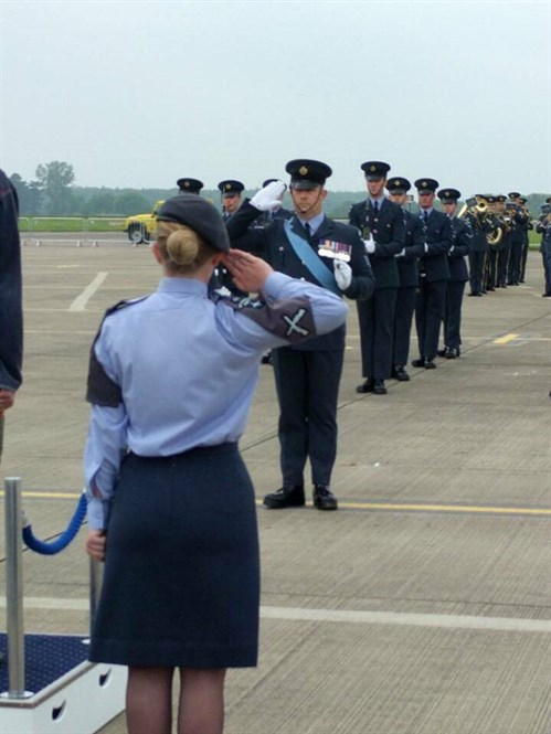 Sgt Kamila Bell returns the salute for the Station Commander