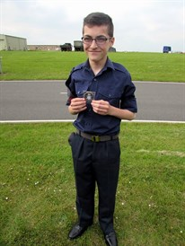 Cdt Curry J with his award for his outstanding work