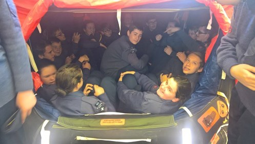 Corby Air Cadets try out a 20 man life raft